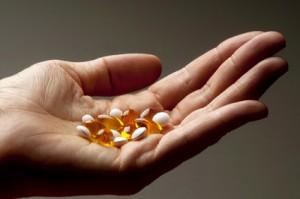 Handvoll Vitamin-Kapseln